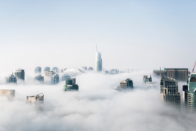 City with skyscrapers in the clouds